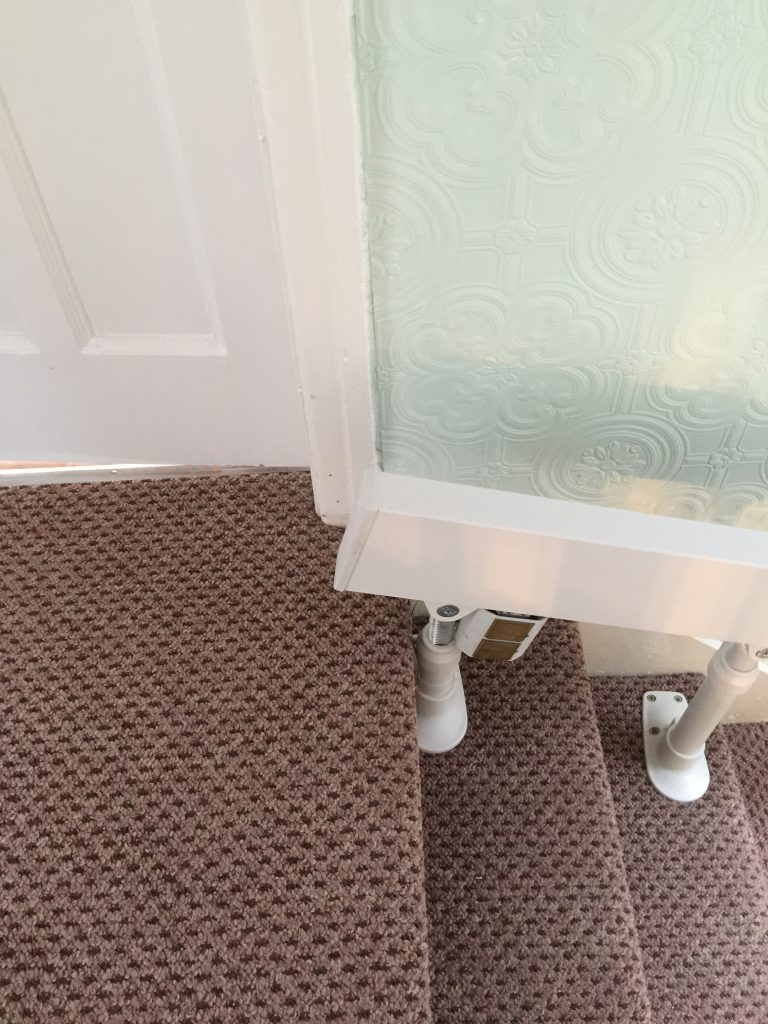 Brooks-180-T565-Curved-Stairlift Rail at top of stairs