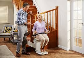 Brooks-Acorn-Spiral-Curve-Chairlift-Halton-Stairlifts with smiling couple