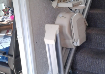 Brooks-Acorn-Straight-Stairlift-Chairlift folded with hinged rail raised