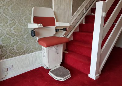 Halton-Sapphire-Curved-Stairlift-Curve-Chairlift in Red Upholstery
