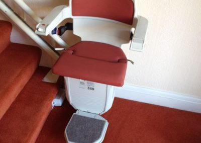 Halton Sapphire Curved Stairlift with Red Upholstery