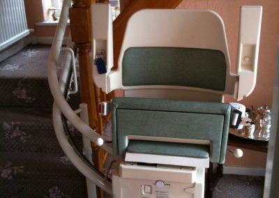 Halton Sapphire Curved Stairlift with Green Upholstery