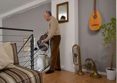 Platinum-Horizon-Stair-lift-Halton-Chair-Lifts with man at top of stairs