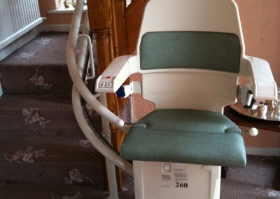 Stannah Sarum Curved Stairlift with Green Upholstery