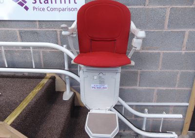 Stannah Stairlifts Sofia Curved Stairlift with Red Upholstery in the Halton Stairlifts Showroom